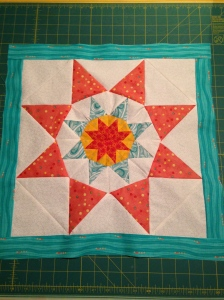 ...until I finally had a little quilt top.  I love the border fabric, which I've used before.  Always reminds me of lovely waves.